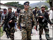 East Timorese soldier Alfredo Reinado (C) flanked by his soldiers during a parade (file photo)