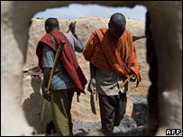 Masaai men in burnt out hut