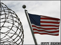 Razor wire and US flag at Guantanamo Bay detention camp