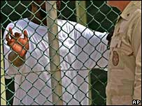 A detainee and guard at Guantanamo Bay, Oct 2007