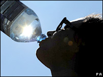 A girl drinks bottled water. File photo