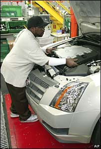 A worker puts the finishing touches on GM's Cadillac CTS