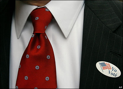 "A voter wears a badge saying ""I have voted"" in Spanish"
