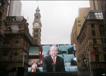 Australian Prime Minister Kevin Rudd seen on a large screen in Sydney