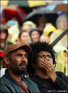 Indigenous Australians watch a live television broadcast