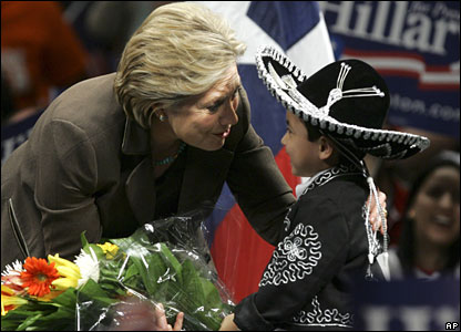 Hillary Clinton greets a young boy dressed in traditional Texan fashion