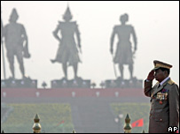 Burma's leader Than Shwe stands in front of statues of ancient kings on Armed Forces Day on 28 March 2007