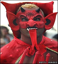 Reveller dressed as a demon