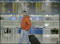 A passenger leaves Athens' airport after the cancellation of all the flights