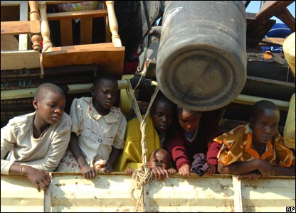 Children look out of a truck at a camp in Kisumu, Kenya (13/02/2008)