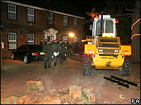 Police and digger on raid