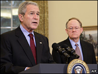 George W Bush speaks in the Oval Office in front of Mike McConnell, the Director of National Intelligence (13 February 2008)