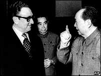 Presidential envoy Henry Kissinger, left, meets Communist China's Chairman Mao Zedong, right