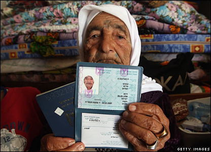 Maryam Amash holds identification documents showing her date of birth (13/02/2008)