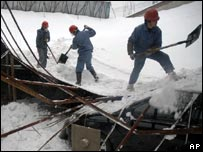 Roof of Chinese car showroom that collapsed under the weight of snow