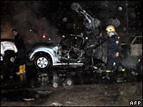 Syrian security and rescue personnel inspect the site of the car bombing in Damascus (12 February 2008)