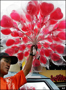 A man selling heart-shaped balloons in Manila, in the Philippines