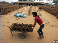 A girl works in a brick kiln in China