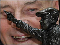 Dickie Bird looks at a scale model of the sculpture