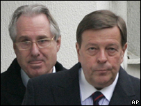 Klaus Zumwinkel (left) leaves home with his lawyer