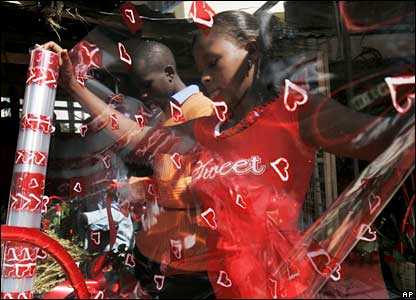 Vendors prepare bunches of red roses at a flower stall on Valentine's Day in Nairobi, Kenya
