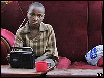 Boy listens to radio in camp for displaced people 2 February 2008