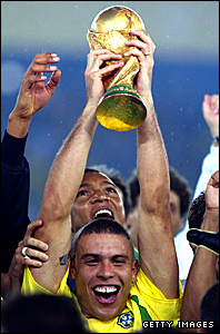 Ronaldo holds aloft the World Cup