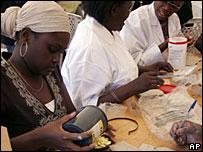 Health workers sorting antibiotics in Kibera, Nairobi
