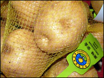 Potatoes carrying a label that reads: 'delicious and safe'