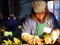 A woman at Changpin farm packs vegetables