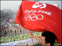Chinese man with a Olympic flag