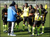 ASEC manager Patrick Liewig addresses his team pre-match