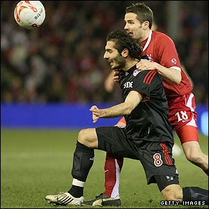 Bayern Munich's Hamit Altintop and Aberdeen's Lee Mair challenge for the ball