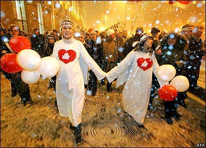 Members of Belarus' Youth Front walk along a snowy street 14/2/08