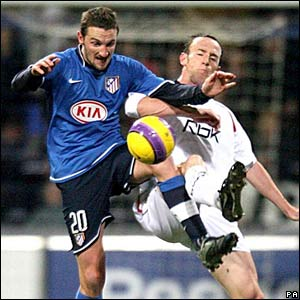 Atletico's Miguel Mista challenges Bolton's Andy O'Brien