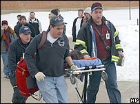 Rescue workers move a shooting victim from the scene