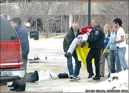 Emergency workers carry injured student at Northern Illinois University
