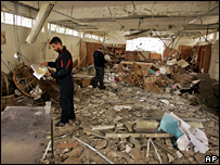YMCA staff inspect the damage done to their library (15 February 2008)