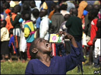Displaced child drinks milk in Nairobi