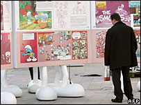 A man looking at boards at the opening of the International Comics Festival (Pierre Andrieu/AFP/Getty Images)