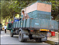 Trucks loaded with animals inside a covered cage wait at Rangoon's Zoological Garden 15 February 2008