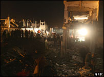 Palestinians inspect the site of a blast at the Bureij refugee camp, central Gaza Strip, 15 February, 2008