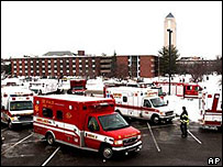 Emergency vehicles gather outside the University
