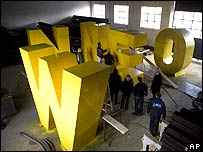 Ethnic Albanian workers painting letters of 'Newborn' - an independence sculpture expected Sunday.
