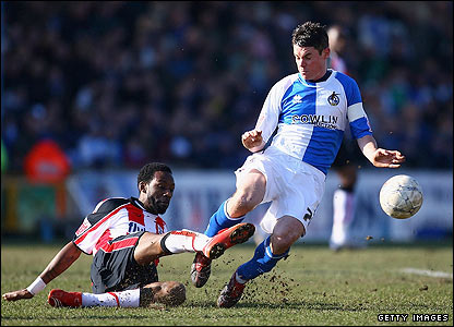 Jason Euell challenges Rovers captain Stuart Campbell