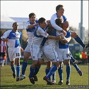 Rickie Lambert is mobbed by his Bristol Rovers team-mates