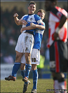 Stuart Campbell and Chris Lines celebrate at the final whistle