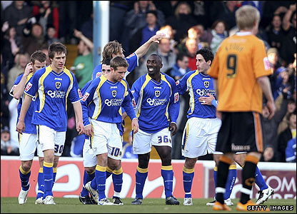 Jimmy Floyd Hasselbaink is congratulated by his Cardiff team-mates