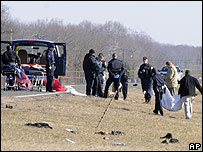 Police at the scene after a car veered into a crowd at an illegal drag race in Accokeek, Maryland, US