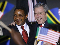 US President George Bush right is greeted by Tanzania's President Jakaya Kikwete as he arrives in Dar es Salaam, Tanzania
